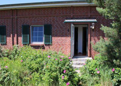 Haus in typischer Bauweise - Eingang zur Ferienwohnung